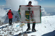 jay with kes flag at summit s